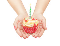 Birthday cupcake in hand Stock Images