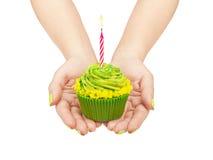 Birthday cupcake in hand Royalty Free Stock Photo