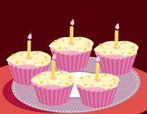 Birthday cupcake image. Pink cupcakes on a red background Royalty Free Stock Photography
