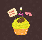 Birthday cupcake with lit candle in shape of number four Royalty Free Stock Image