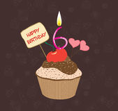 Birthday cupcake with lit candle in shape of number six Royalty Free Stock Images