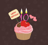 Birthday cupcake with lit candle in shape of number ten Royalty Free Stock Photography