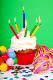 Birthday cupcake with lots of candles Royalty Free Stock Images