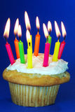 Birthday cupcake with lots of candles Stock Photos