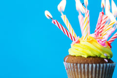 Birthday cupcake with many burning candles Stock Photography