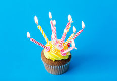 Birthday cupcake with many burning candles Stock Photo
