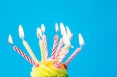 Birthday cupcake with many burning candles Stock Image