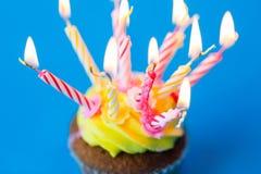 Birthday cupcake with many burning candles Royalty Free Stock Photo
