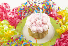 Birthday Cupcake with Party Decorations Royalty Free Stock Photography