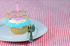Birthday cupcake on a plate Royalty Free Stock Photography