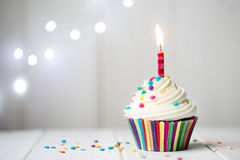 Birthday cupcake. Cupcake with a single candle royalty free stock images