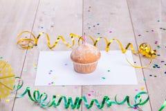 Birthday cupcake on table wood background Stock Image
