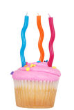 Birthday cupcake with three candles Stock Photos
