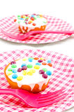 Birthday cupcake witch candies on a plate. Birthday cupcake with candies on a plate isolated stock image