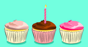Birthday cupcakes. Trio of frosted cupcakes in pinks and chocolate brown with a birthday candle Stock Images