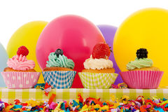 Birthday cupcakes with balloons Stock Images