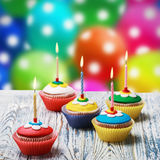 Birthday cupcakes with burning candles Royalty Free Stock Image