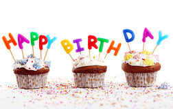 Birthday cupcakes with colorful candles Royalty Free Stock Photo