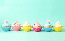 Birthday cupcakes on green background Royalty Free Stock Photos