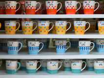 Birthday cups on the shelves Royalty Free Stock Image