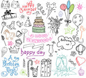 Birthday elements. Hand drawn set with birthday cake, balloons, gift and festive attributes. Children drawing doodle collection, i Stock Photos