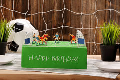 Birthday football cake on the party or reception Stock Image