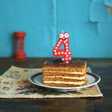 Birthday is four years. A piece of birthday cake Royalty Free Stock Photos