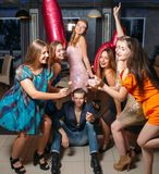 Birthday with friends. Happy 18th. Joyful company with bengal lights, celebration in night club. Modern youth life, festivity concept Stock Photo