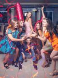 Birthday with friends. Happy 18th. Joyful company with bengal lights, celebration in night club. Modern youth life, festivity concept Stock Images