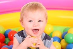 Birthday of fun boy in balls. Royalty Free Stock Image