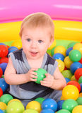 Birthday of fun boy in color balls. Stock Photos