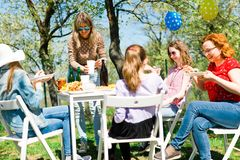 Birthday garden party during summer sunny day. Eating on picnic royalty free stock photos