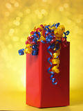 Birthday gift. Nice birthday gift with colorful ribbons, yellow background Stock Photos