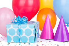 Birthday Gift Box. With balloons and party hats on a white background Royalty Free Stock Images