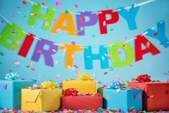 Birthday gift boxes with paper confetti Royalty Free Stock Photos