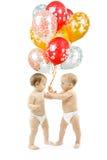 Birthday gift. Children present balloons. Small children present colorful balloons over white background. Birthday gift Stock Photo