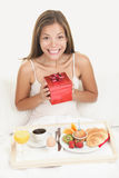 Birthday gift - happy smiling woman Stock Image
