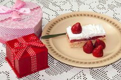 Birthday gifts with strawberry cake on the table Stock Photo