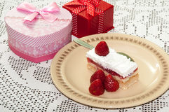 Birthday gifts with strawberry cake on the table Royalty Free Stock Photo