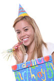 Birthday Girl. A pretty young birthday girl holding a present royalty free stock photo