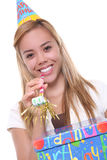 Birthday Girl. A pretty young birthday girl holding a present stock image