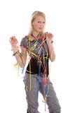 Birthday girl. Cute blond girl with confetti around her on white background Stock Photos