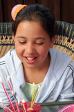 Birthday girl. Looking at candles royalty free stock image