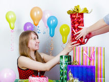 Birthday. The girl accepts gifts Stock Image
