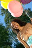 Birthday girl with balloons Stock Photo