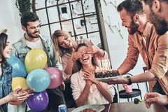 Birthday girl. Group of happy people celebrating birthday among friends and smiling while having a party stock photos