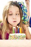 Birthday girl blows cake candles Stock Photo