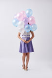 Birthday girl. With bunch of colorful balloons royalty free stock photography