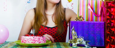Birthday. Girl with cake and gifts Stock Photo