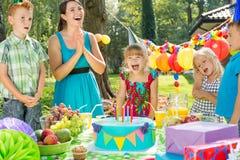 Birthday girl and cake Stock Photography